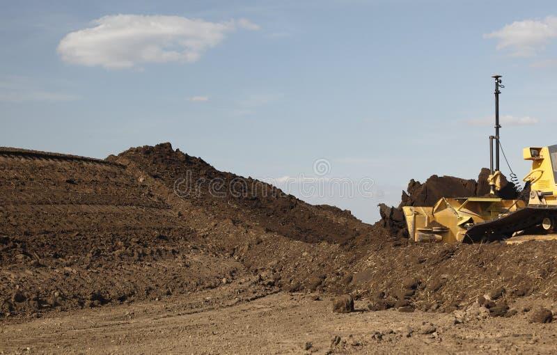 Bulldozer moving dirt stock photography