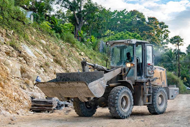 Bulldozer in operation by male construction worker stock photography
