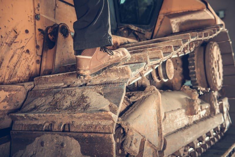 Bulldozer Operator Concept. Heavy Duty Bulldozer Operator Concept Photo. Construction Equipment. Caterpillar Track Closeup stock image