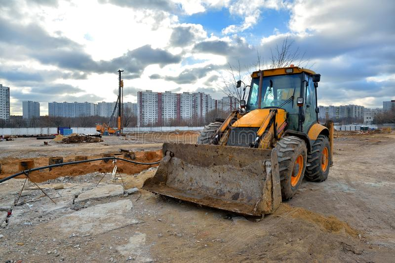 Bulldozer and pile driving machine on a construction site. Heavy bulldozer and pile driving machine on a construction site stock photography