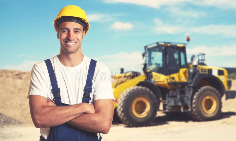 Bulldozer with pointing latin american construction worker royalty free stock photos