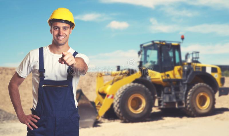 Bulldozer with pointing latin american construction worker stock photo