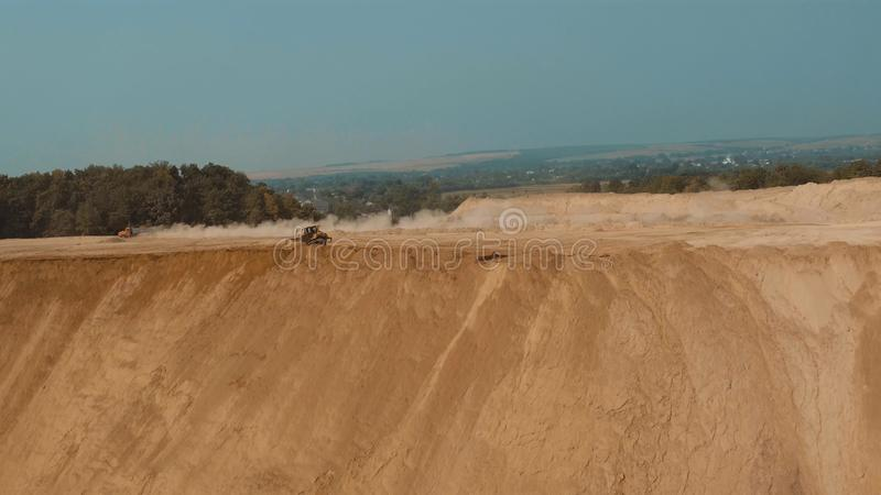 Bulldozer in Sand Pit Sand Unfolds. Aerial photo royalty free stock images