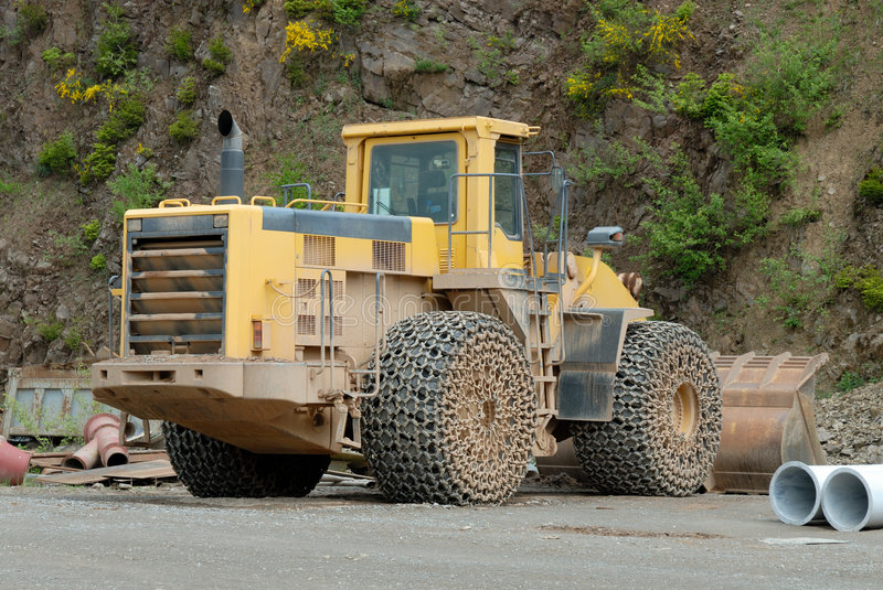 Bulldozer in a stone pit. Large bulldozer in a stone pit royalty free stock photography