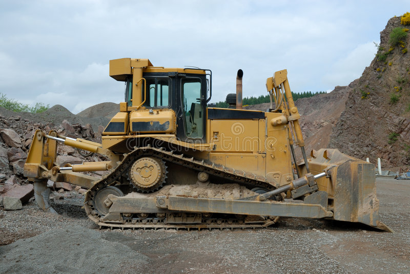 Bulldozer in a stone pit. Huge bulldozer in a stone pit royalty free stock image