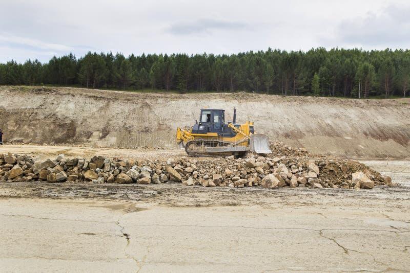 Bulldozer sul cantiere della strada fotografia stock