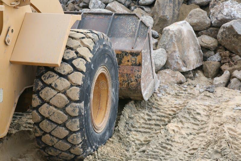 Bulldozer sulla spiaggia fotografia stock libera da diritti