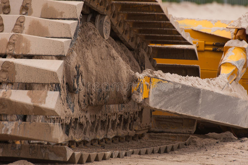 Bulldozer track. A bulldozer put to bed for the night stock photos