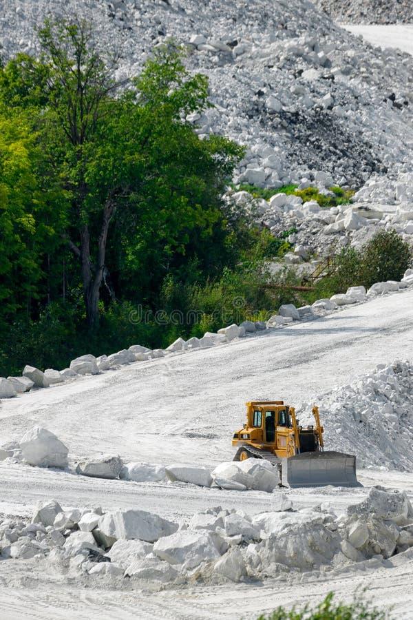 Bulldozer on White Road of Marble Mine royalty free stock photos