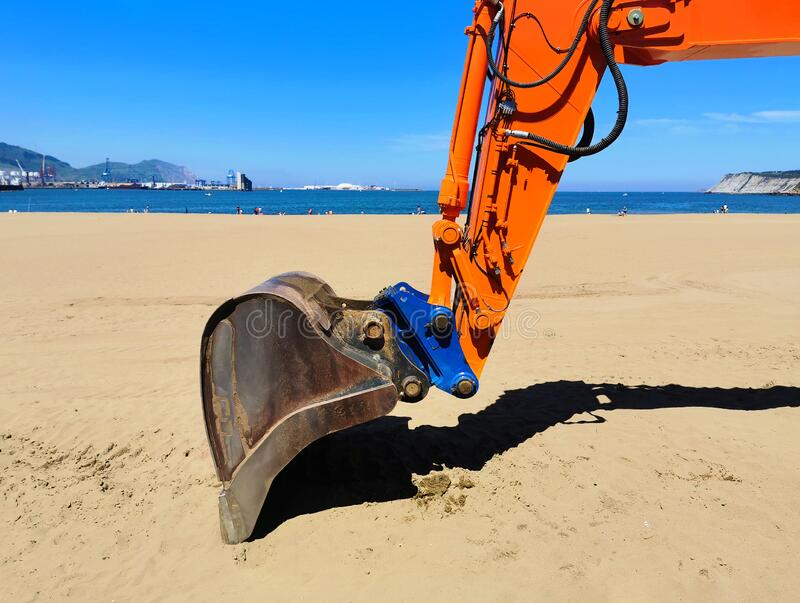 bulldozer cleaning the beach royalty free stock photos