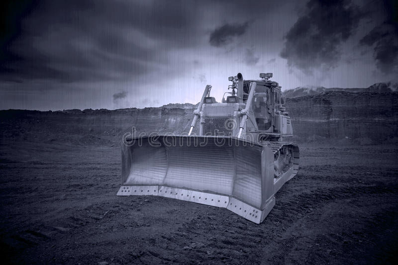 Download The Bulldozer Working In Coal Mines Stock Photo - Image: 83708011
