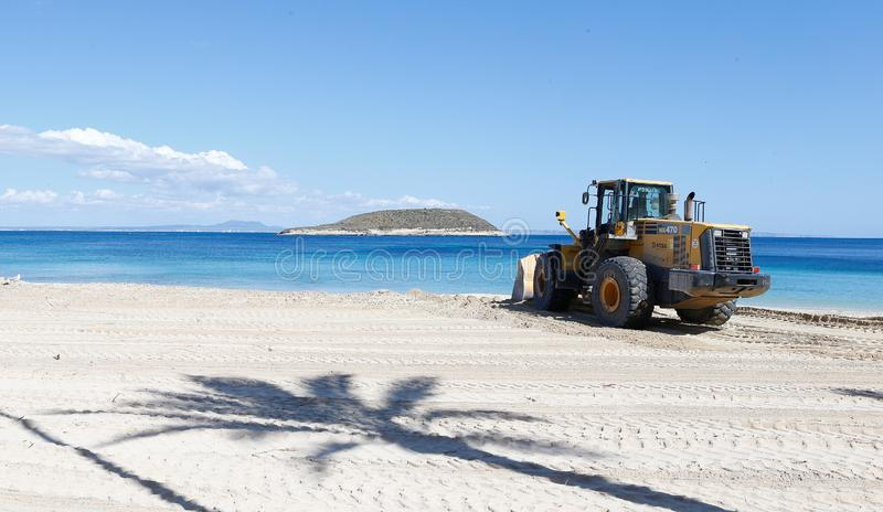 Bulldozer working in Magaluf beach in Mallorca royalty free stock images
