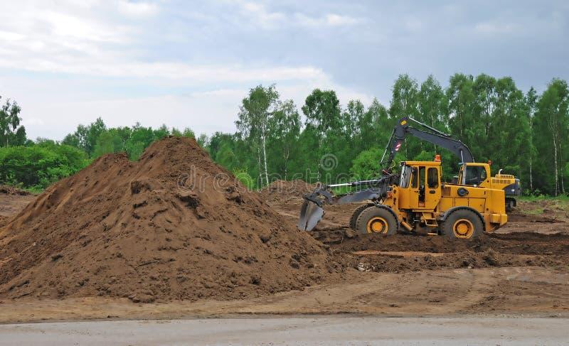 bulldozergrävare arkivfoto