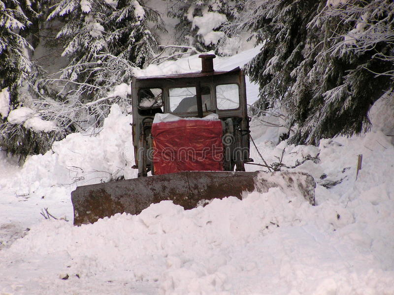 Bulldozers and winter. Snow calamity,Bulldozers old machine royalty free stock photography