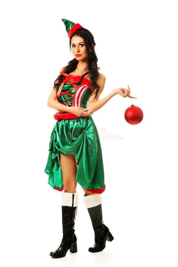 Bulle accrochante de Noël de femme sur son doigt image libre de droits