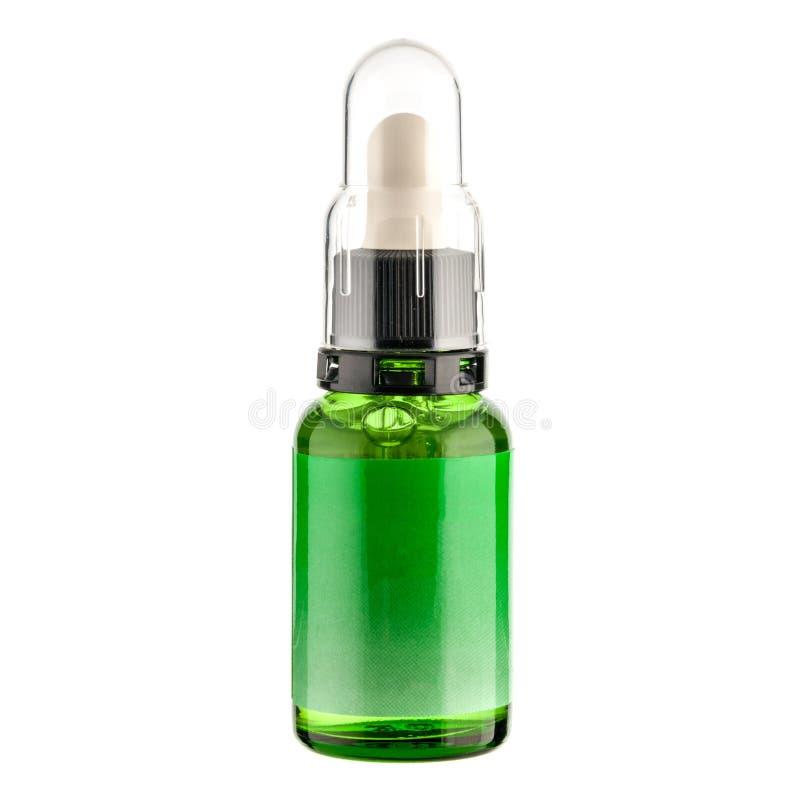 Bulle cosmétique transparente avec le liquide vert clair photographie stock libre de droits
