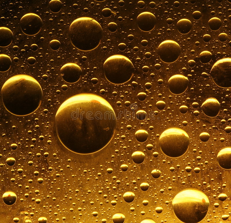 Bulles d'or photographie stock