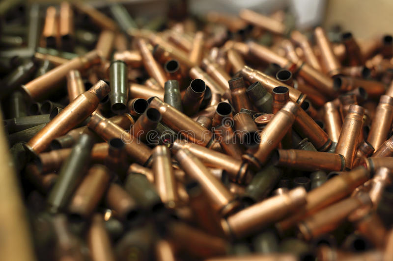 The bullet, brass scales on the cartridges royalty free stock photography