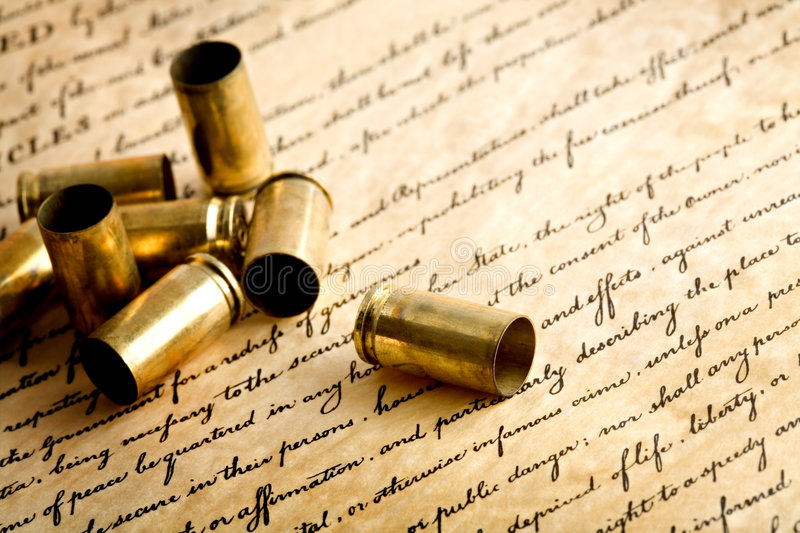 Download Bullet Casings On Bill Of Rights Stock Photo - Image of freedom, golden: 2062144
