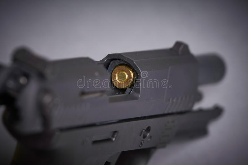 Bullet in the chamber. Of a handgun royalty free stock photos
