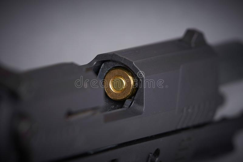 Bullet in the chamber. Of a handgun stock image