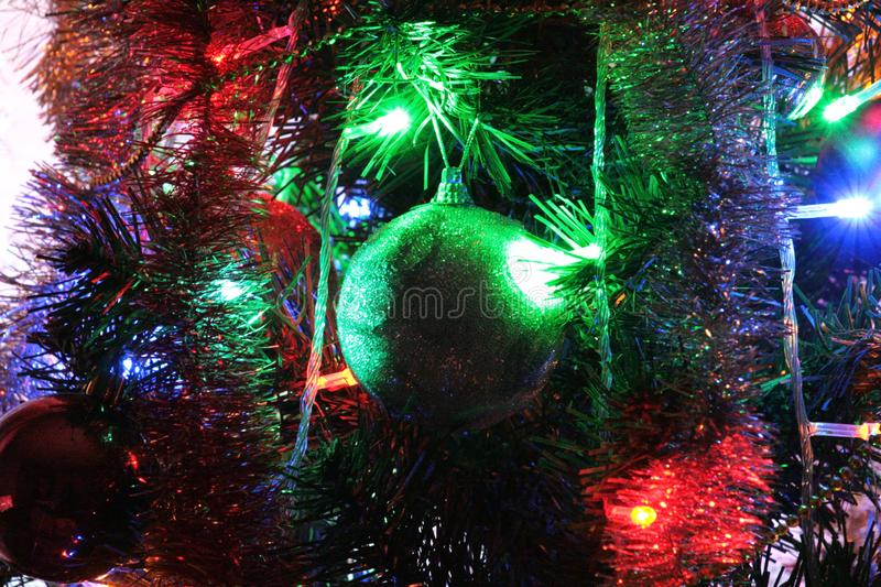 Bullet, Christmas decoration and beautiful illumination. Yellow, green, red, and blue Christmas lights illuminate this toy, creating the effect of a fairy tale stock images