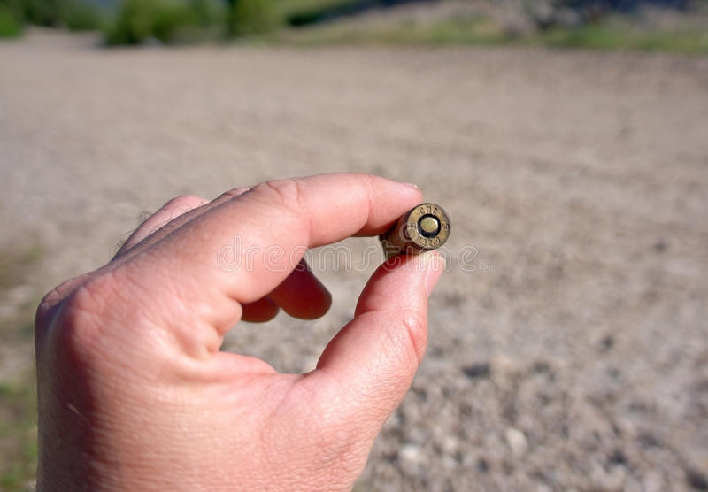 Download Bullet in hand stock image. Image of bullet, endurance - 24740581