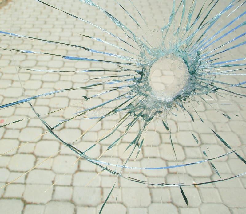 Bullet hole in the broken glass