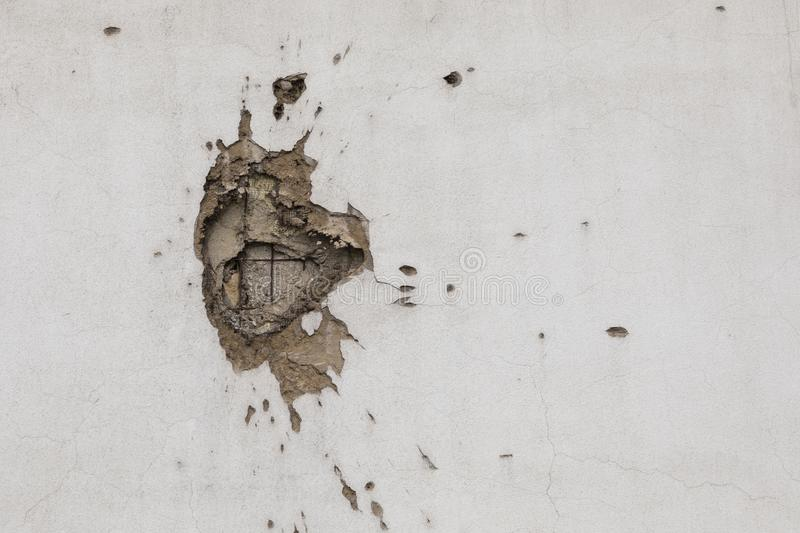 Bullet hole on building wall in Sarajevo stock images