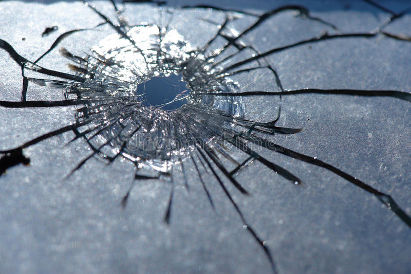 Download A bullet hole is in glass stock image. Image of crime - 16454071