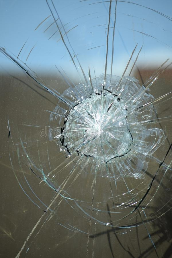 Bullet hole glass stock images