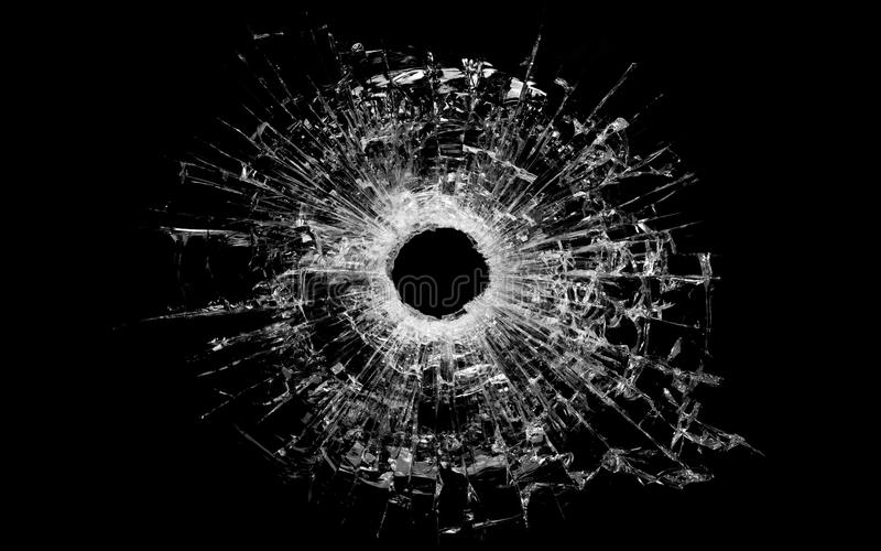 Bullet hole in glass isolated on black stock photos