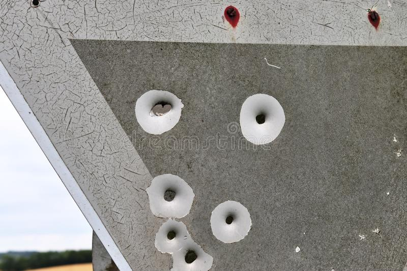 Bullet holes in a german traffic sign from a gun shooting exercise stock image