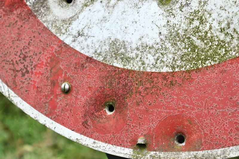 Bullet holes in a german traffic sign from a gun shooting exercise royalty free stock photo