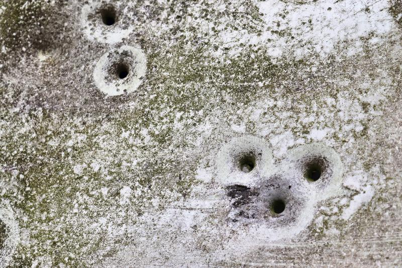 Bullet holes in a german traffic sign from a gun shooting exercise stock images