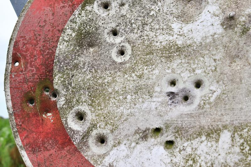 Bullet holes in a german traffic sign from a gun shooting exercise royalty free stock images