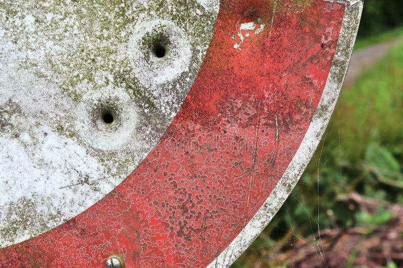 Bullet holes in a german traffic sign from a gun shooting exercise stock photos