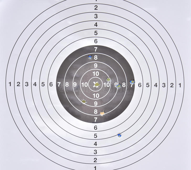 Bullet holes in middle of practice target royalty free stock images