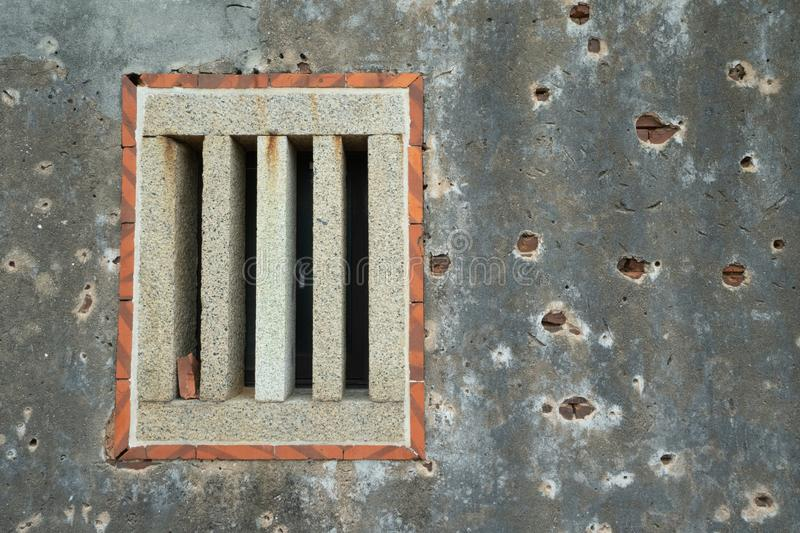 Bullet holes in an old Taiwanese building royalty free stock photos