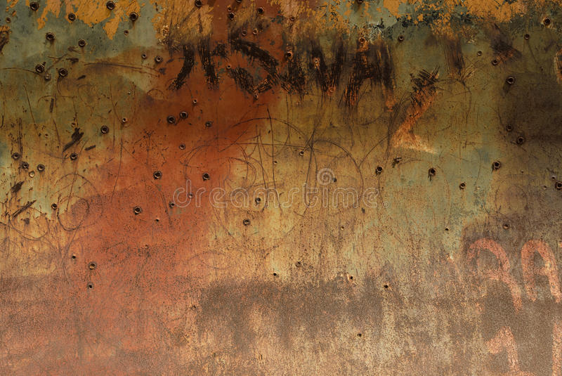 Bullet Holes in Rusty Metal Plate stock image