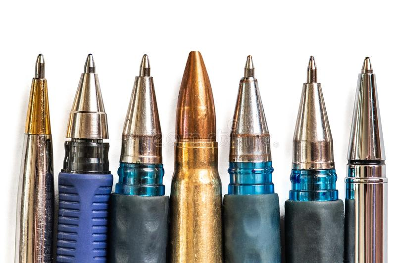 Bullet and pens on white background. Freedom of the press is at risk concept. World press freedom day concept.  stock image