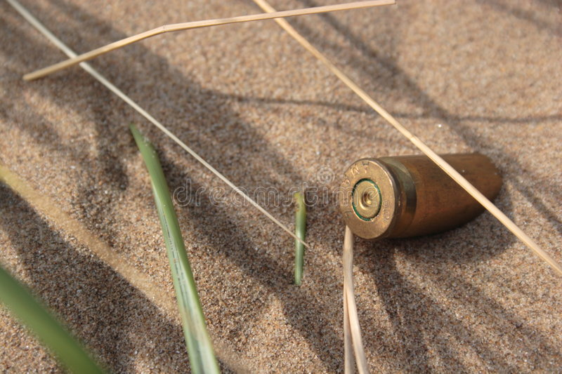 Download Bullet in the Sand 2 stock image. Image of casing, invasion - 3150955