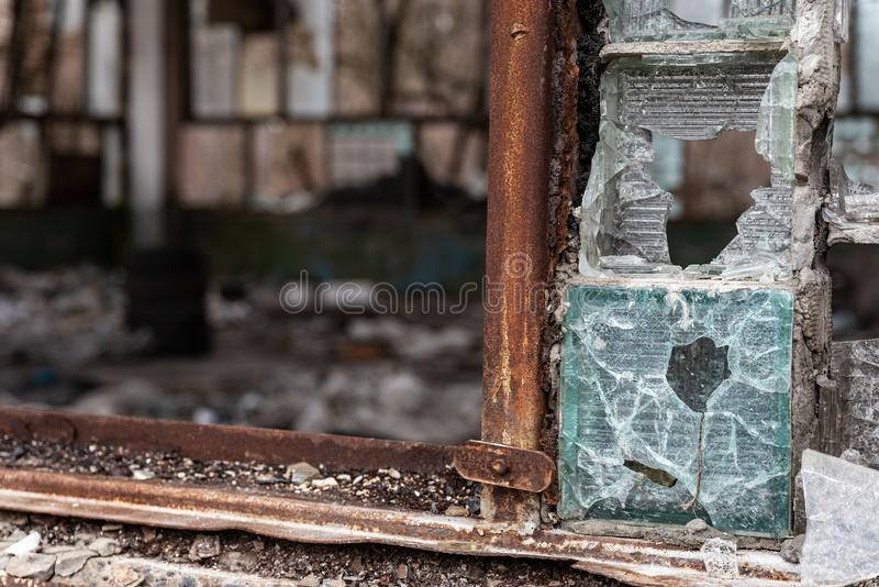 Bullet-shattered glass window in an abandoned building stock photography