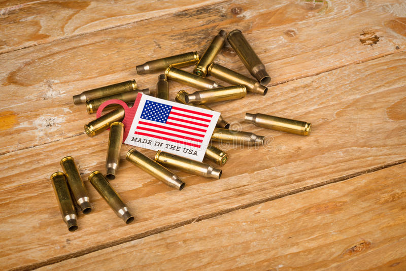 Bullet shells and US flag. A cultural concept stock photo
