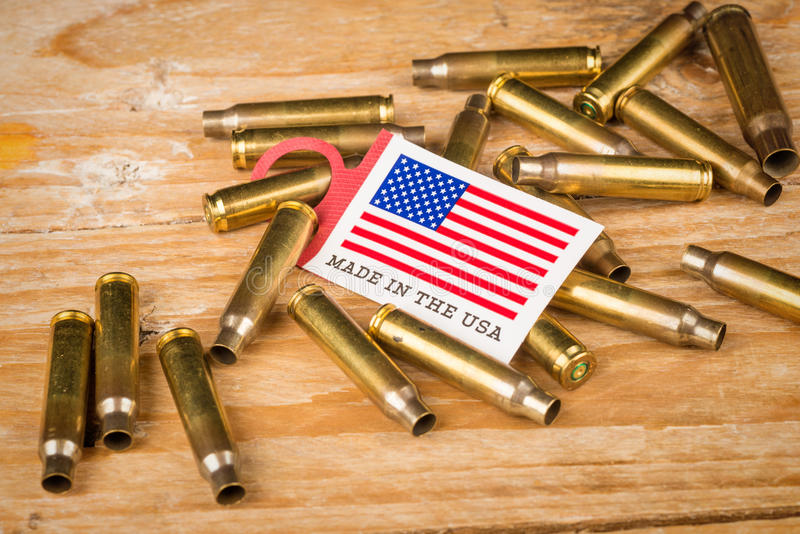 Bullet shells and US flag. A cultural concept royalty free stock image