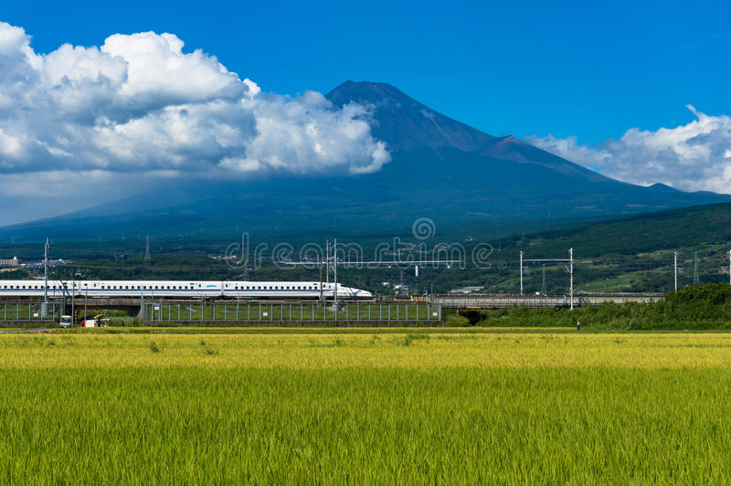 Bullet train, Shinkansen travel below Mt. Fuji in Japan royalty free stock photos