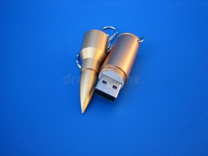 Bullet USB flash memory. Usb memory in the form of a gold bullet. Remarkable flesh memory design stock image
