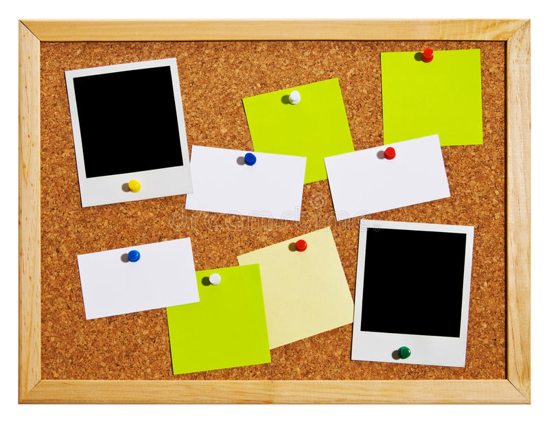Bulletin board. Cork bulletin board with notes, business cards and polaroid cards