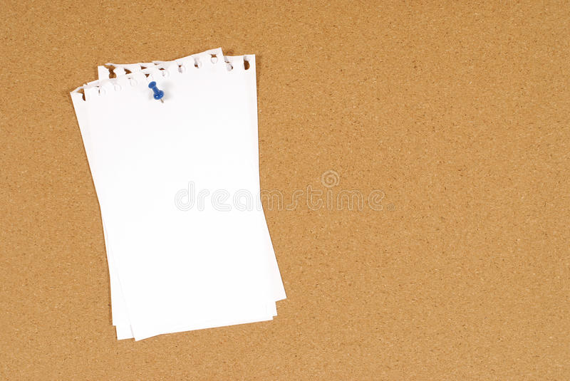 download torn note paper pinned to a cork bulletin board background copy space stock photo