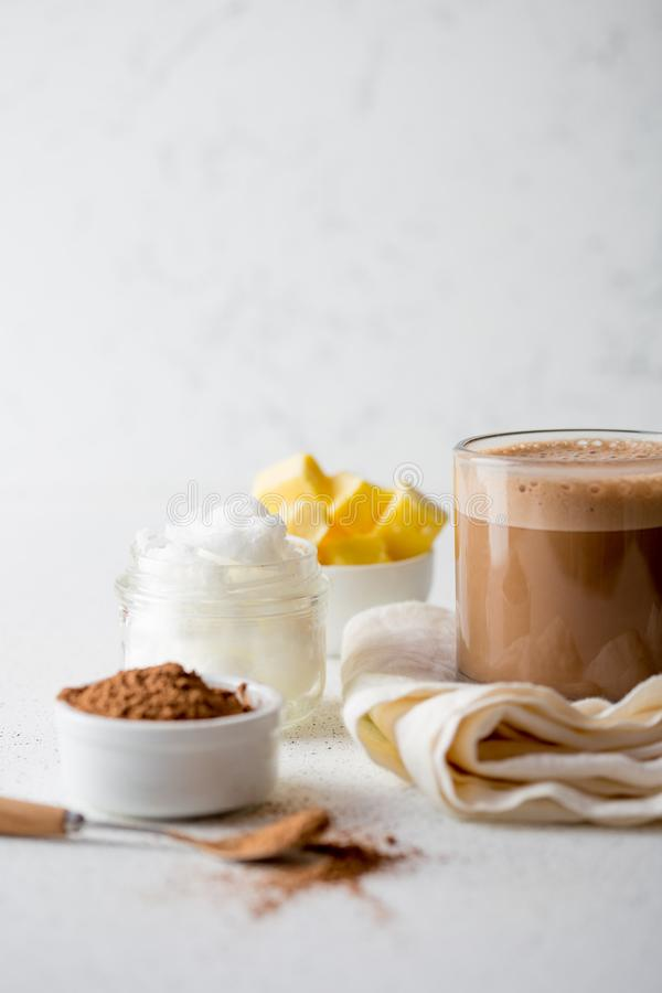 BULLETPROOF CACAO. Ketogenic keto diet hot drink. Cacao blended with coconut oil and butter. Cup of bulletproof cacao stock photos